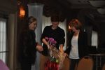Jane & Alex giving Pat an orchid as thanks for organizing the fundraiser